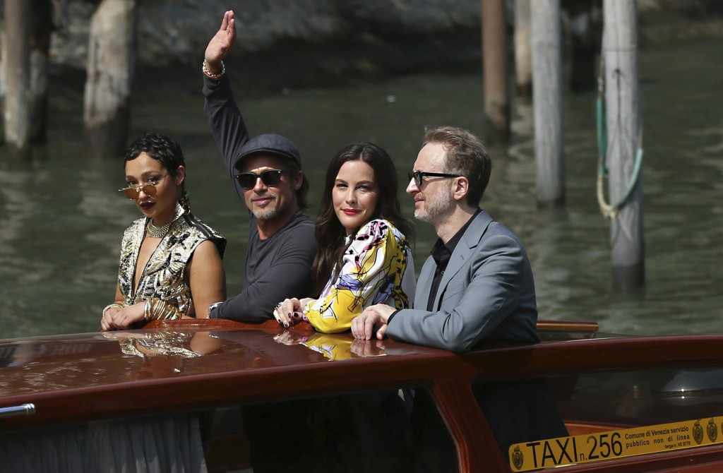 File - Actors Ruth Negga, from left, Brad Pitt, Liv Tyler and director James Gray arrive for the photo call of 'Ad Astra' at the Venice Film Festival....