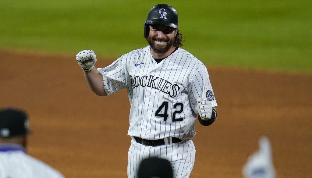 Colorado Rockies pinch-hitter Daniel Murphy celebrates after his walkoff RBI-single off San Diego Padres relief pitcher Craig Stammen in the ninth inn...