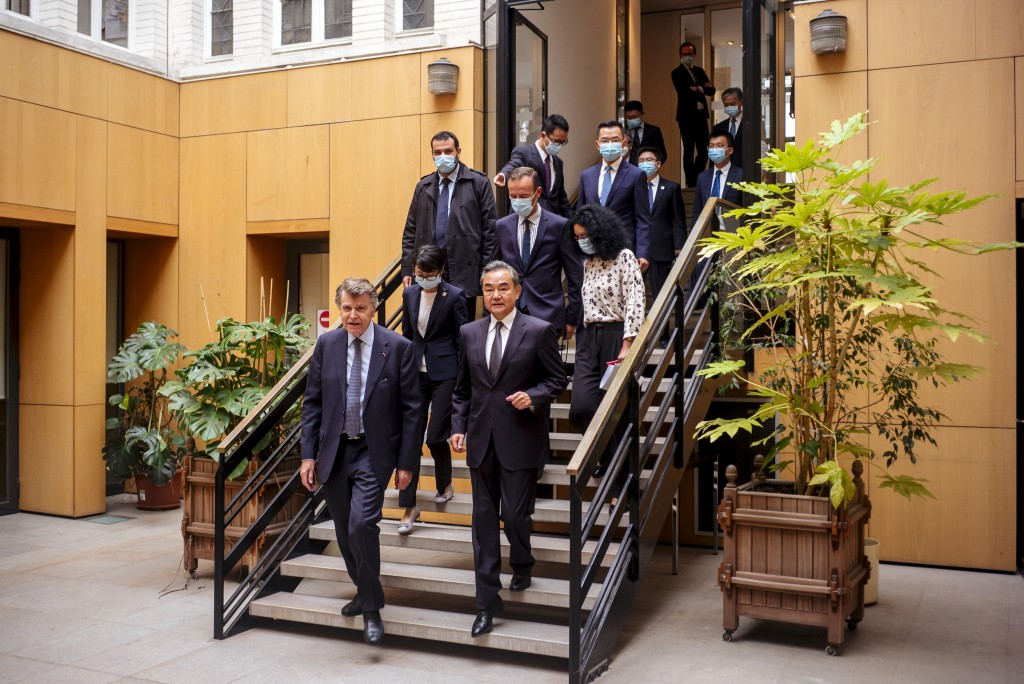 Chinese Foreign Minister Wang Yi, right, and French Institute for International Relations director Thierry de Montbrial arrives for a press conference...