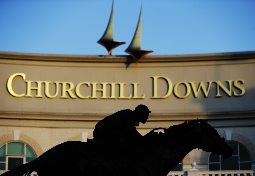 FILE - In this May 6, 2020 file photo a statue of Barbaro is silhouetted at the entrance of Churchill Downs in Louisville, Ky.  The Trump administrati...