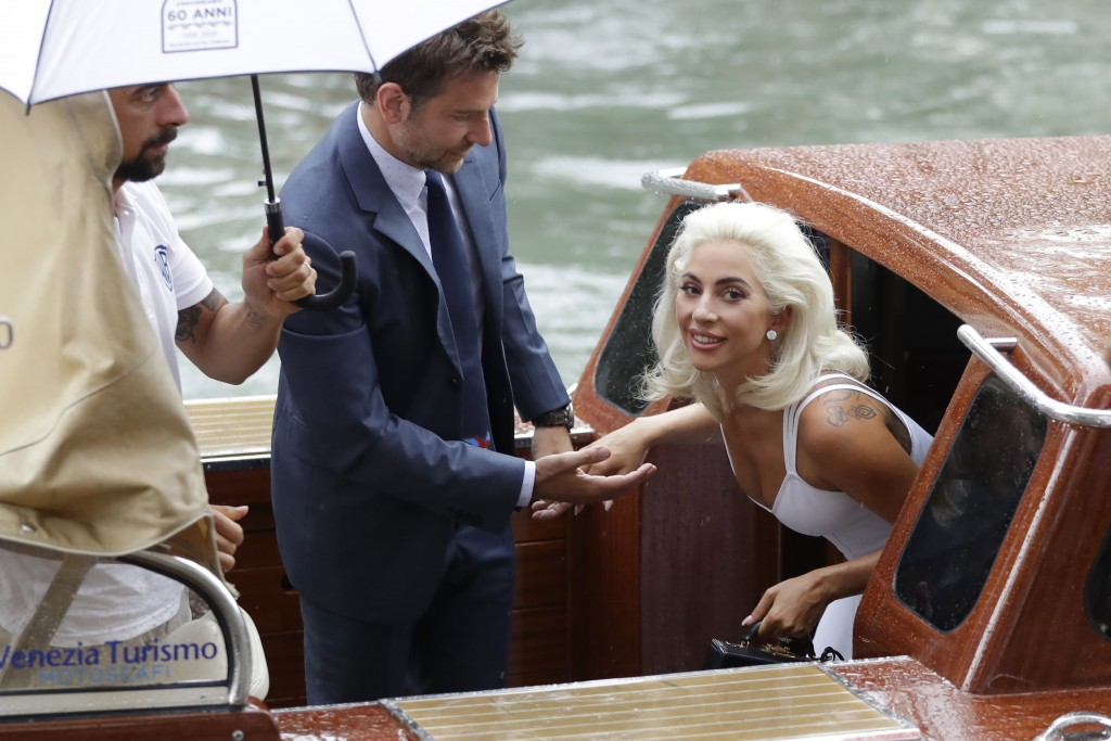 File - Singer and actress Lady Gaga, right, and actor Bradley Cooper arrive at the Venice Film Festival for the photo call of the film 'A Star Is Born...