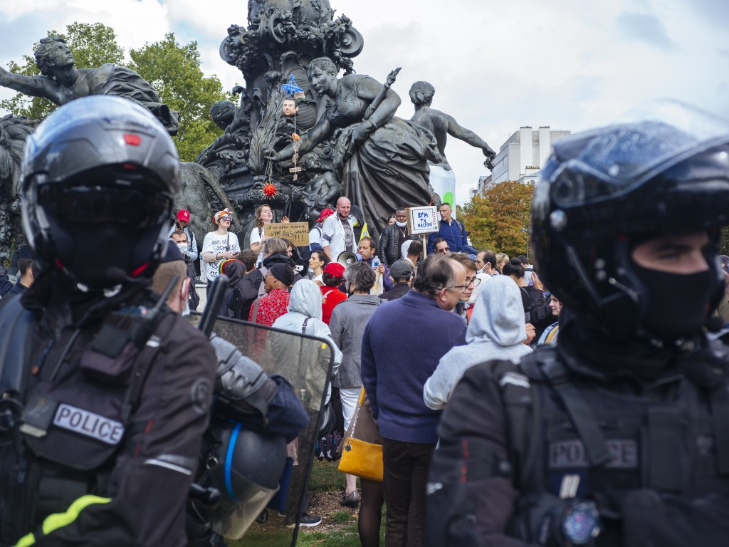 Demonstrators gather during an anti-mask demonstration in Paris, Saturday, Aug. 29, 2020. A few hundred people rallied Saturday at the Place de la Nat...