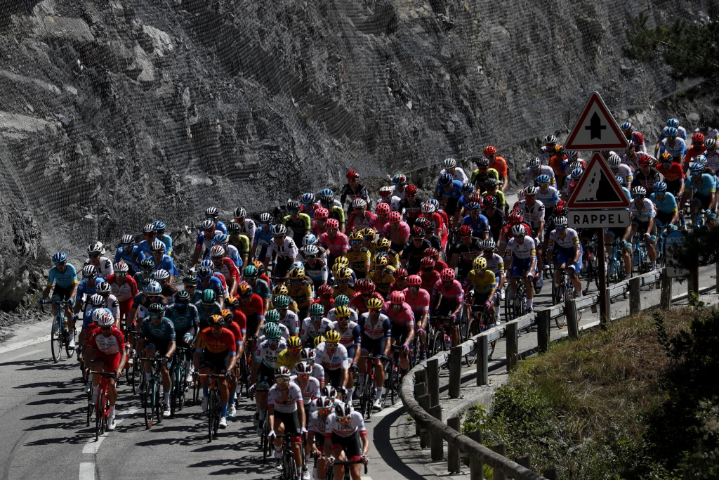 The pack rides during the second stage of the Tour de France cycling race over 186 kilometers (115,6 miles) with start and finish in Nice, southern Fr...