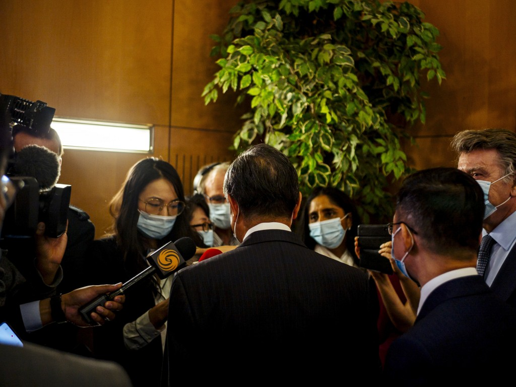 Chinese Foreign Minister Wang Yi speaks with journalists after a press conference at the Institute for International Relations in Paris, Sunday, Aug. ...