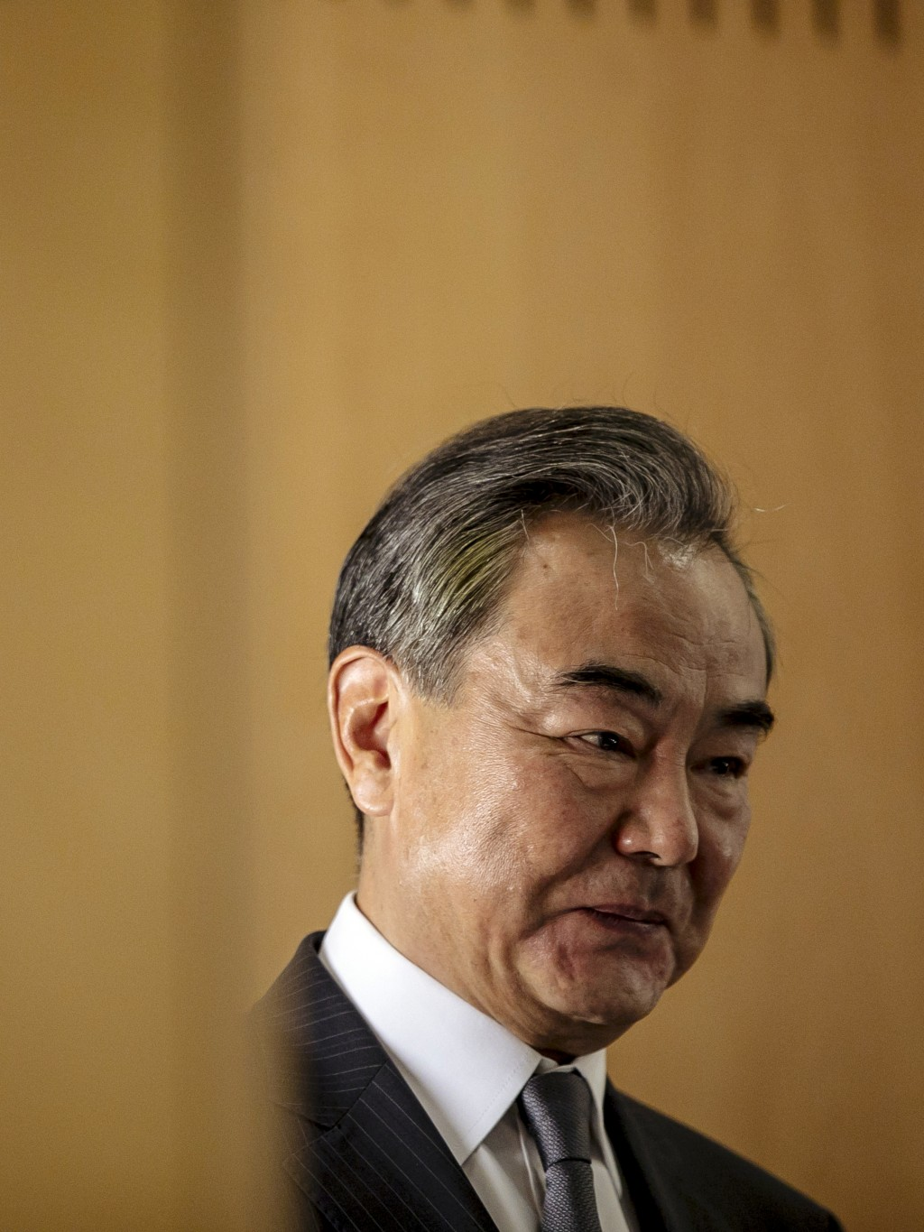 Chinese Foreign Minister Wang Yi delivers a speech during a press conference at the Institute for International Relations in Paris, Sunday, Aug. 30, 2...