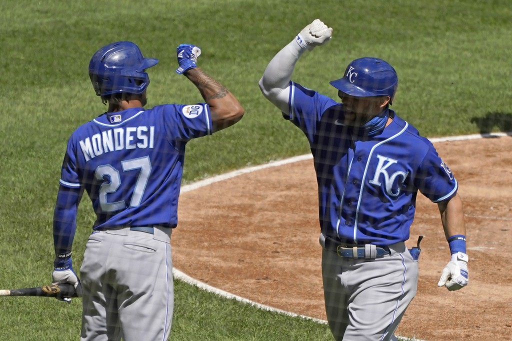 Kansas City Royals' Alex Gordon, right, celebrates with Adalberto Mondesi after hitting a solo home run against the Chicago White Sox during the secon...