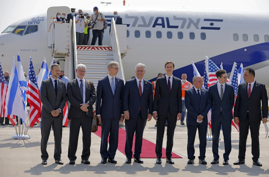 U.S. Presidential Adviser Jared Kushner, center right, and U.S. National Security Adviser Robert O'Brien, center left, pose with members of the Israel...