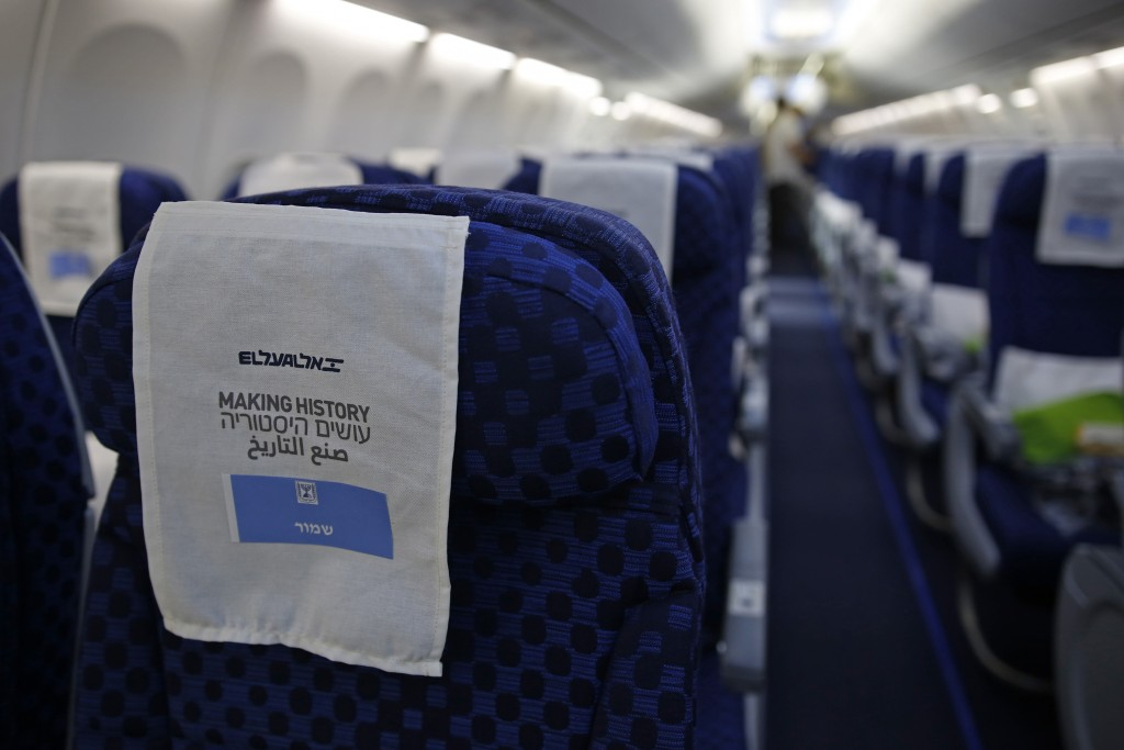 """A seat covering reading in Arabic, English and Hebrew """"making history"""" is in the Israeli flag carrier El Al's airliner which will carry Israeli and U...."""