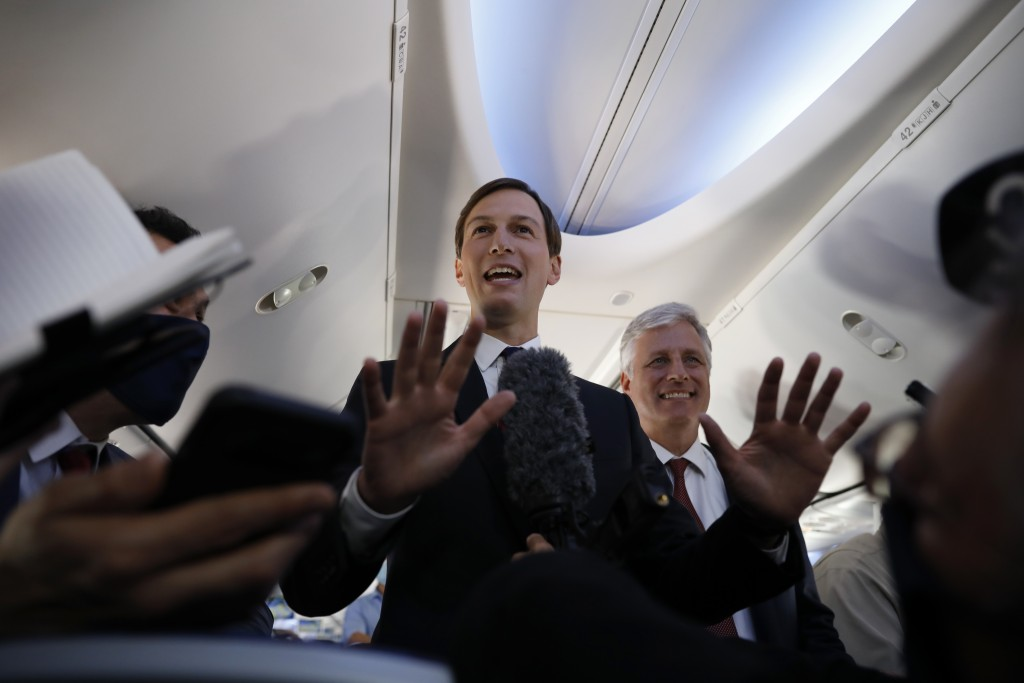 U.S. President Donald Trump's senior adviser Jared Kushner, center, stands with U.S. National Security Advisor Robert O'Brien while speaking to journa...