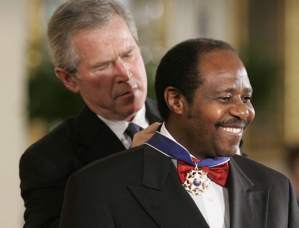 FILE - In this Wednesday, Nov. 9, 2005 file photo, President Bush awards Paul Rusesabagina, who sheltered people at a hotel he managed during the 1994...