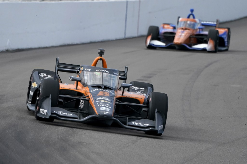 Pato O'Ward (5) drives into Turn 1 followed by Scott Dixon (9) during the IndyCar auto race at World Wide Technology Raceway on Sunday, Aug. 30, 2020,...