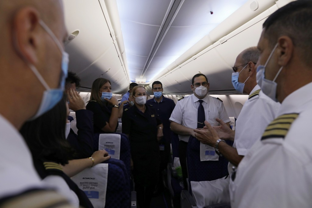 People including flight crew members are seen in the Israeli flag carrier El Al's airliner which will carry Israeli and U.S. delegations to Abu Dhabi ...