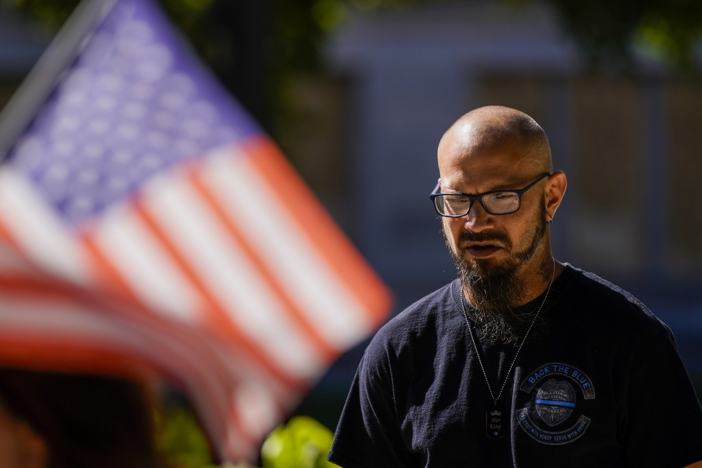 Dustin Bose participates in a Blue Lives Matter rally Sunday, Aug. 30, 2020, in Kenosha, Wis. (AP Photo/Morry Gash)
