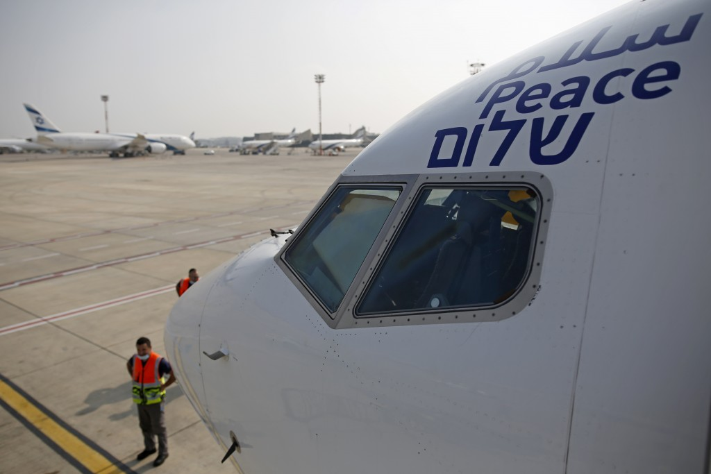 """The Arabic, English and Hebrew word for """"peace"""" is seen on the Israeli flag carrier El Al's airliner which will carry Israeli and U.S. delegations to ..."""