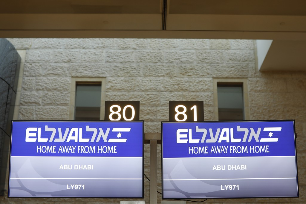 Screens display flight number of Israeli flag carrier El Al's airliner which will carry Israeli and U.S. delegations to Abu Dhabi for talks meant to p...