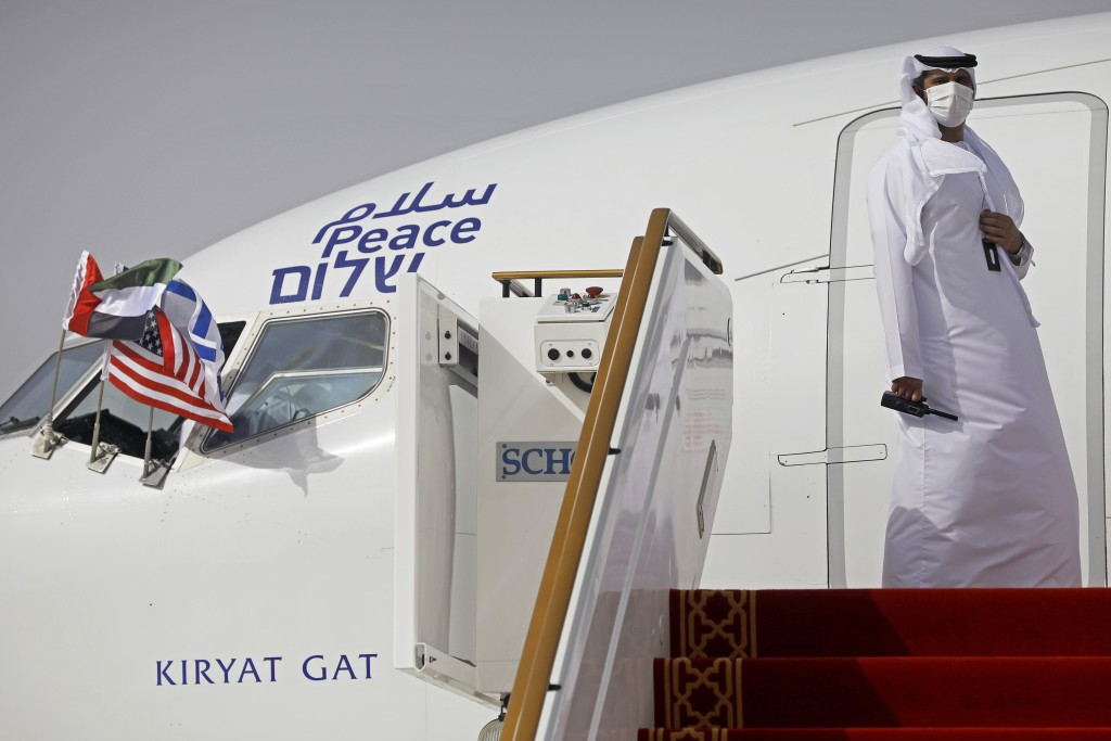 An official stands at the door of an Israeli El Al airliner after it landed in Abu Dhabi, United Arab Emirates, Monday, Aug. 31, 2020. The Star of Dav...