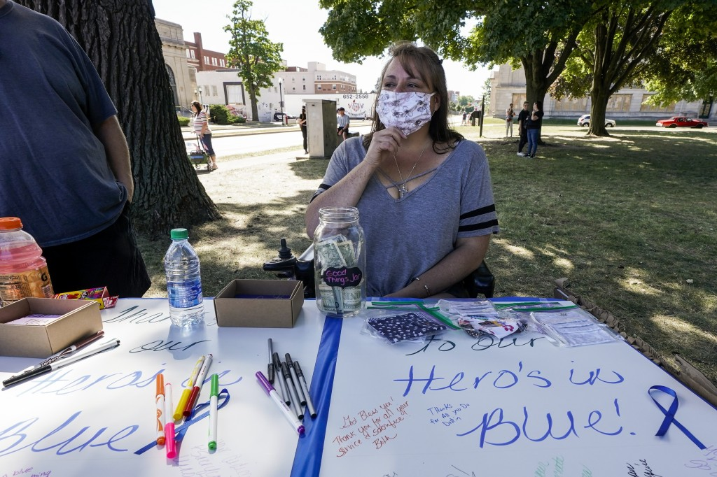 Jennifer Payton participates in a Blue Lives Matter rally Sunday, Aug. 30, 2020, in Kenosha, Wis. (AP Photo/Morry Gash)