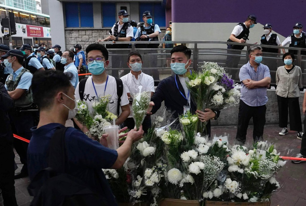 People place flowers outside the Prince Edward subway station in Hong Kong Monday, Aug. 31, 2020.  Aug. 31 is the first anniversary of police raid on ...
