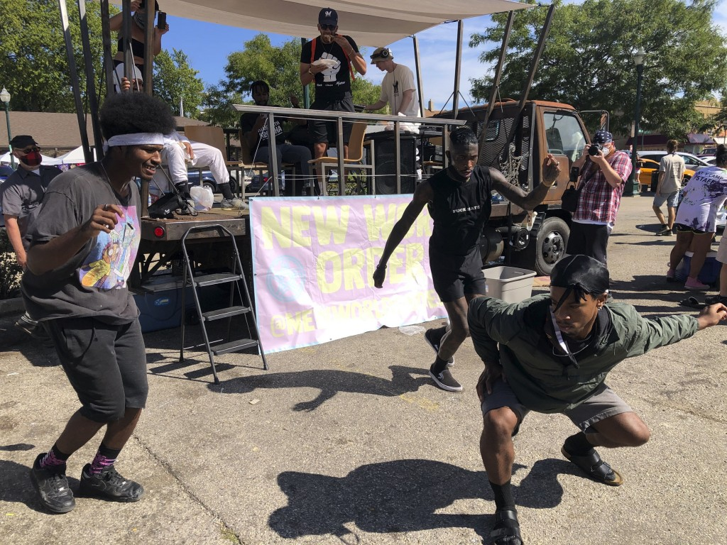 """Dancers from the artist group New World Order in Kenosha, Wis., dance Sunday, Aug. 30, 2020, at an """"Uptown Revival"""" event meant to gather donations fo..."""