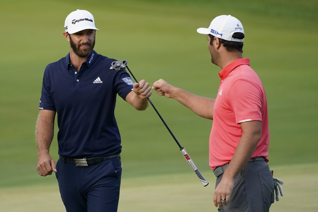 Jon Rahm, right, is congratulated by Dustin Johnson on the first playoff hole during the final round of the BMW Championship golf tournament at the Ol...