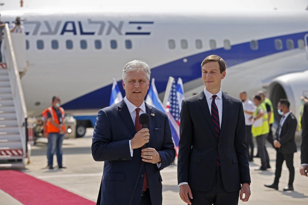 U.S. Presidential Adviser Jared Kushner, right, listens to US National Security Adviser Robert O'Brien speaking ahead of boarding the El Al's flight, ...