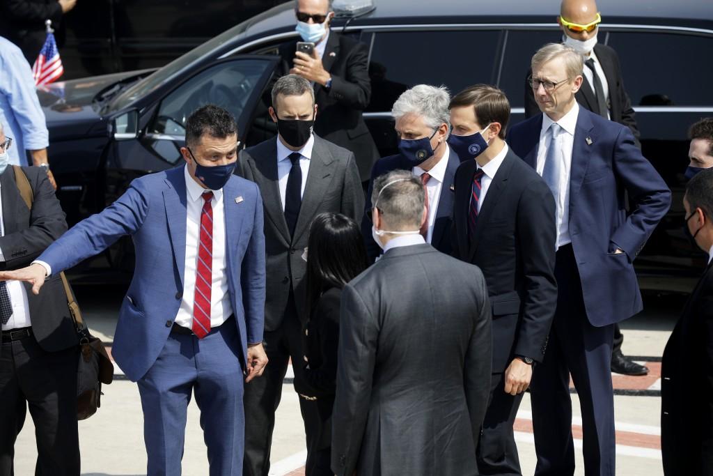 U.S. National Security Advisor Robert O'Brien, center right, and U.S. President Trump's senior adviser Jared Kushner, second from right, prepare to bo...