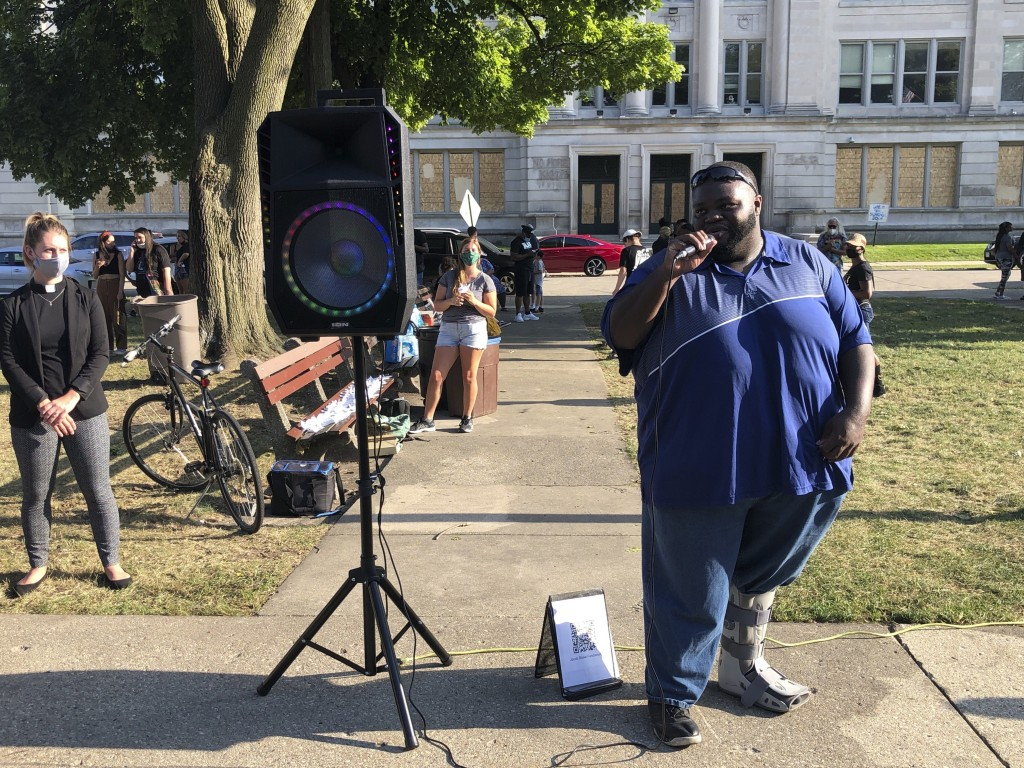 Truck driver and Kenisha, Wis., community activist Isaac Wallner, 30, speaks at a vigil on Friday, Aug. 28, 2020, in honor of Jacob Blake, a Black man...