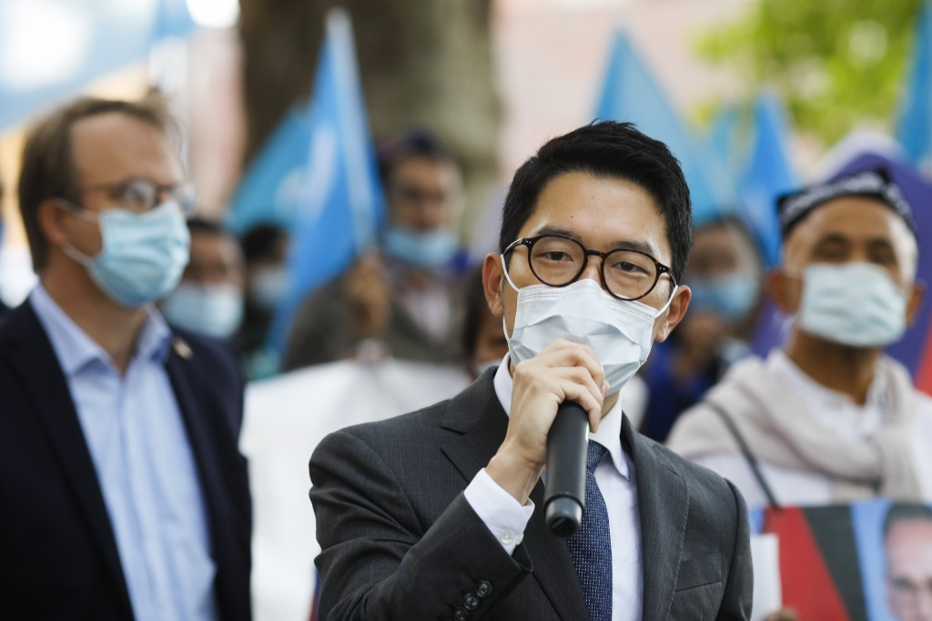 Hong Kong activist Nathan Law speaks as he takes part in a protest during the visit of Chinese Foreign Minister Wang Yi in Berlin, Germany, Tuesday, S...