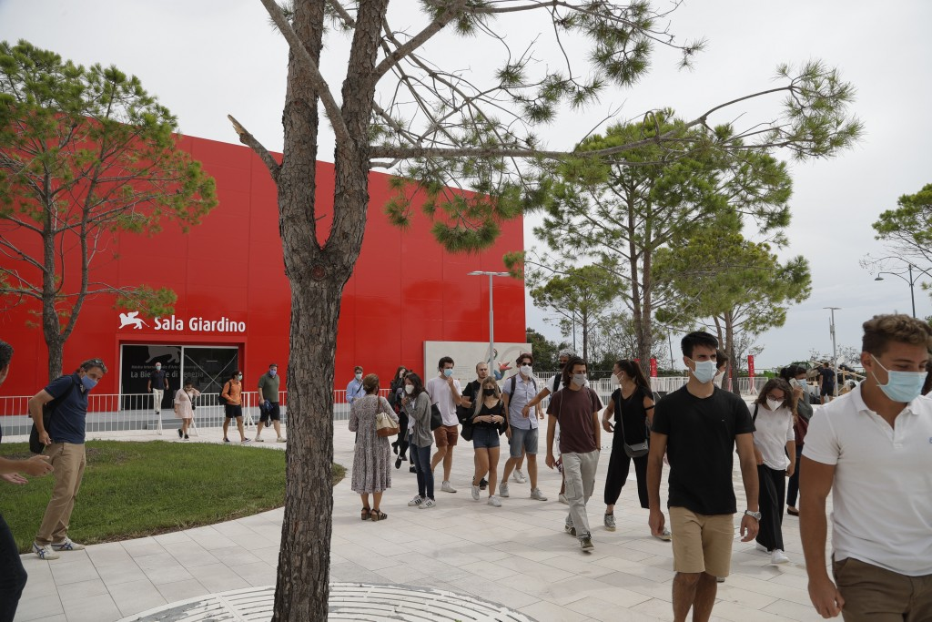 Festival workers leave a meeting where they were briefed about procedures for the 77th edition of the Venice Film Festival at the Venice Lido, Italy, ...