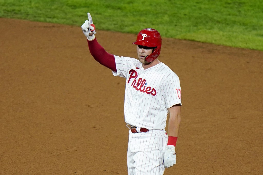 Philadelphia Phillies' Rhys Hoskins reacts after hitting a two-run double off Washington Nationals pitcher Wander Suero during the seventh inning of a...