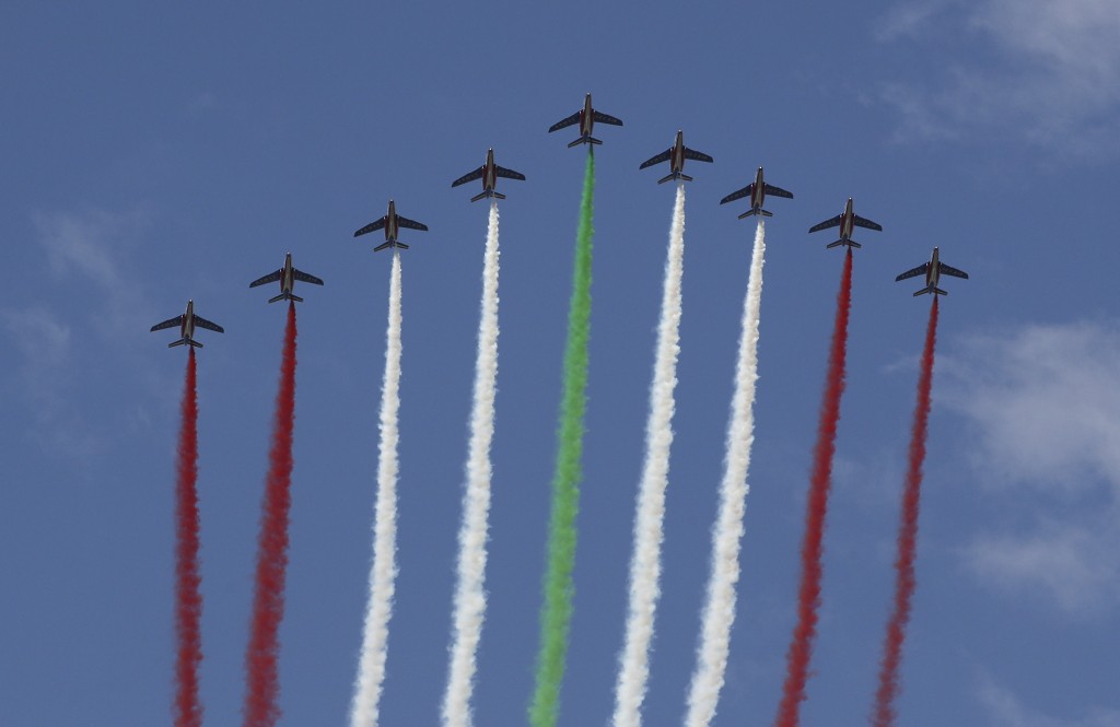 Aircrafts release smoke with the colors of the Lebanese flag as French President Emmanuel Macron panted a cedar in Jaj, near Beirut, Tuesday Sept. 1, ...