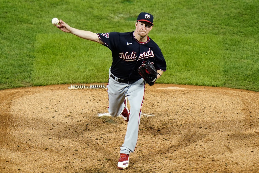 Washington Nationals' Erick Fedde pitches during the third inning of a baseball game against the Philadelphia Phillies, Monday, Aug. 31, 2020, in Phil...