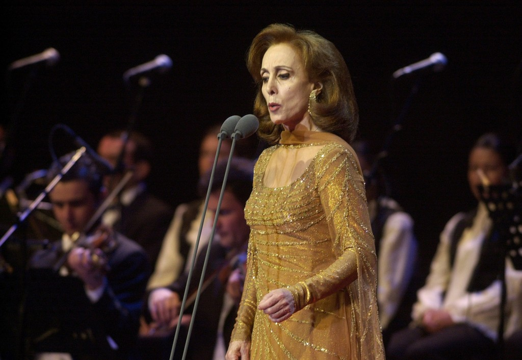 FILE - In this Aug. 9, 2002 file photo, Fairouz, one of the Arab world's most prominent and revered singers performs in front of thousands of fans dur...