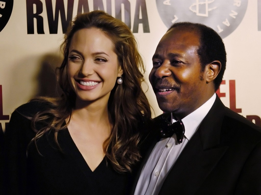 "FILE - In this Thursday, Dec. 2, 2004 file photo, Paul Rusesabagina, the inspiration for the film ""Hotel Rwanda,"" poses with actress Angelina Jolie at..."