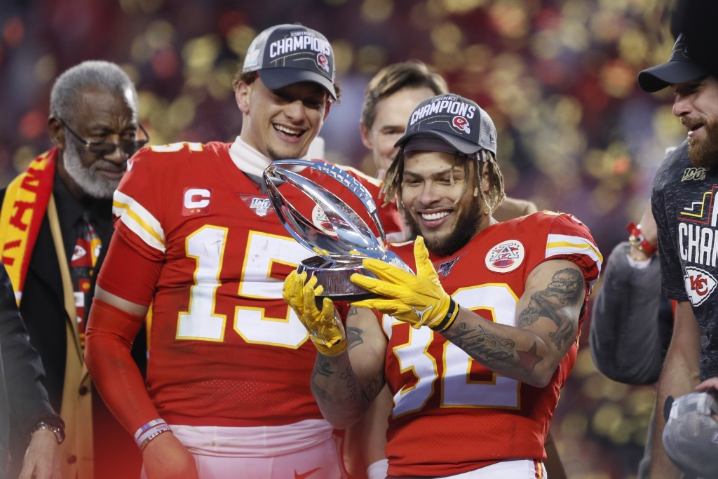 FILE - In this Sunday, Jan. 19, 2020, file photo, Kansas City Chiefs' Tyrann Mathieu and Patrick Mahomes (15) hold up the Lamar Hunt Trophy after the ...