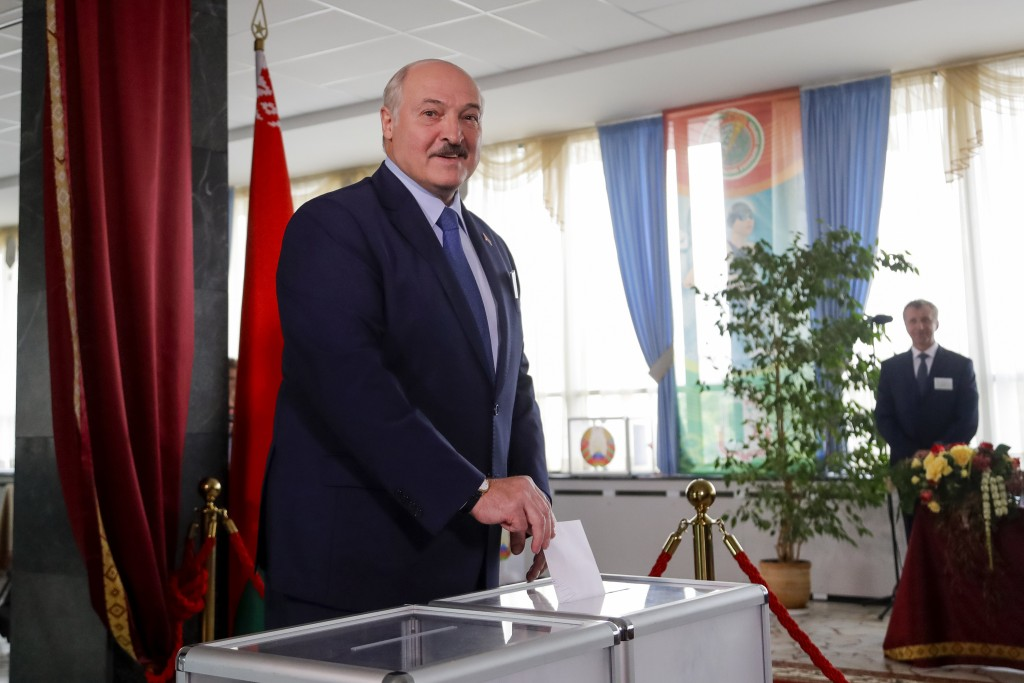 FILE - In this Aug. 9, 2020, file photo, Belarusian President Alexander Lukashenko casts his ballot at a polling station during the election in Minsk,...
