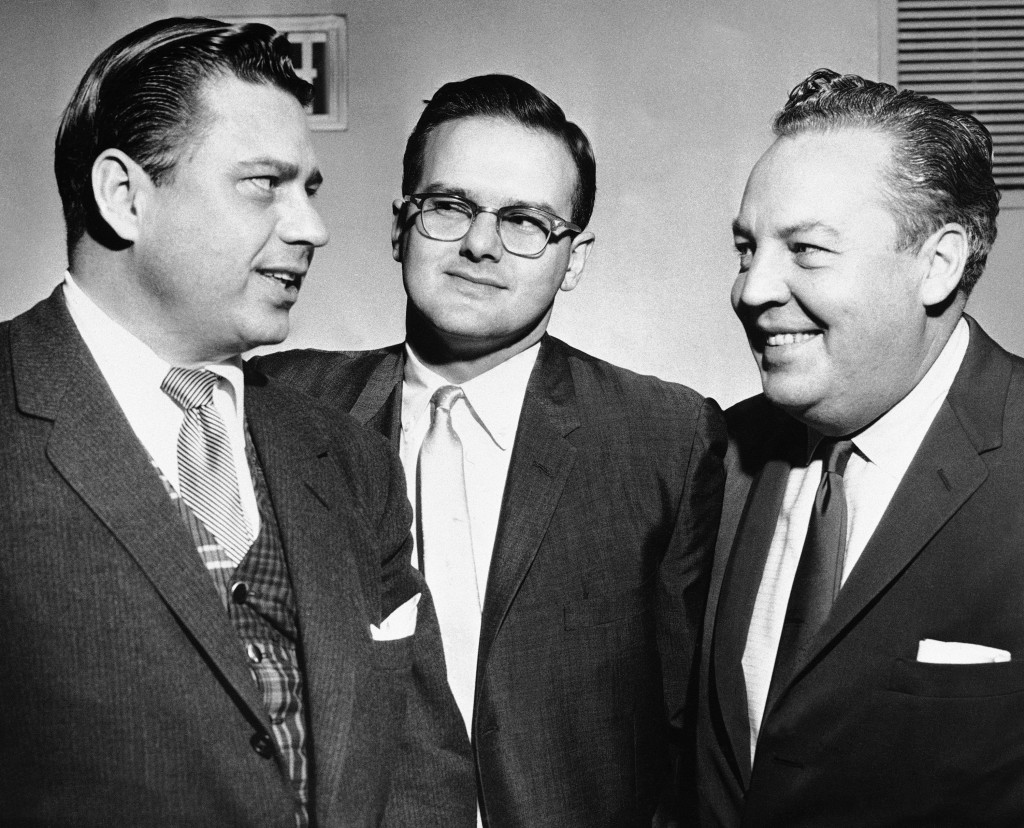 FILE -- This Jan. 26, 1960, file photo shows American Football League president Lamar Hunt, center, flanked by Bud Adams, left, owner of the Houston A...