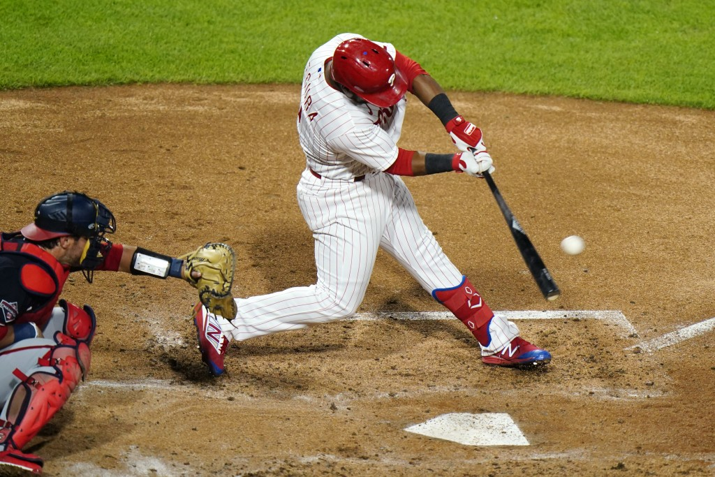 Philadelphia Phillies' Jean Segura hits a three-run double off Washington Nationals pitcher Erick Fedde during the fourth inning of a baseball game, M...