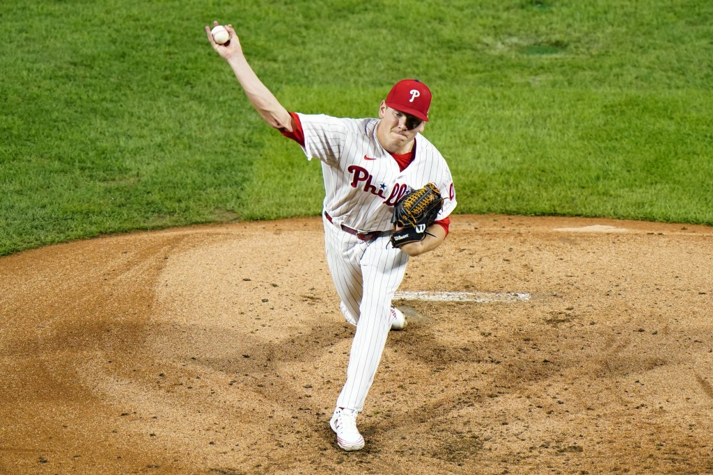 Philadelphia Phillies' Spencer Howard pitches during the third inning of a baseball game against the Washington Nationals, Monday, Aug. 31, 2020, in P...