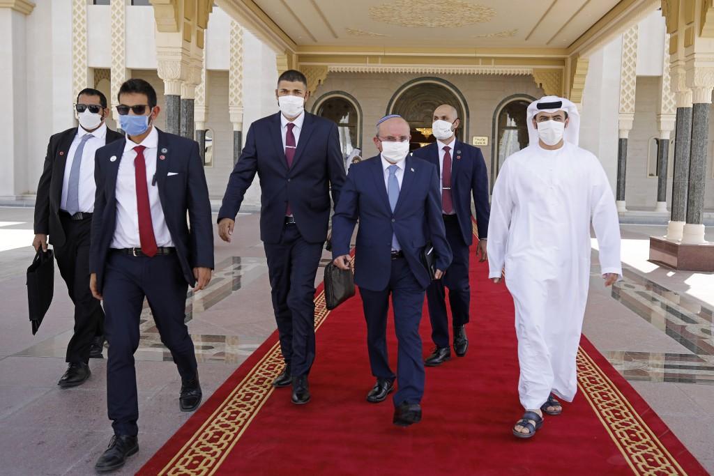 Israeli National Security Advisor Meir Ben-Shabbat, center, walks toward a plane as he leaves Abu Dhabi, Arab Emirates, Tuesday, Sept. 1, 2020. (Nir E...