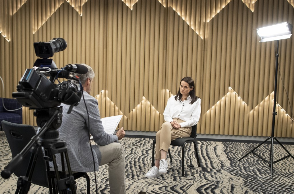 Sviatlana Tsikhanouskaya, former candidate for the Belarus' presidential elections listens to a question, during an interview with the Associated Pres...