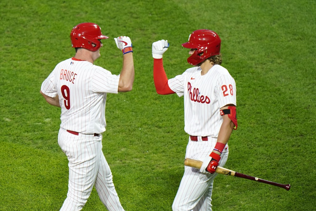 Philadelphia Phillies' Jay Bruce, left, and Alec Bohm celebrate after Bruce's home run off Washington Nationals pitcher Erick Fedde during the second ...