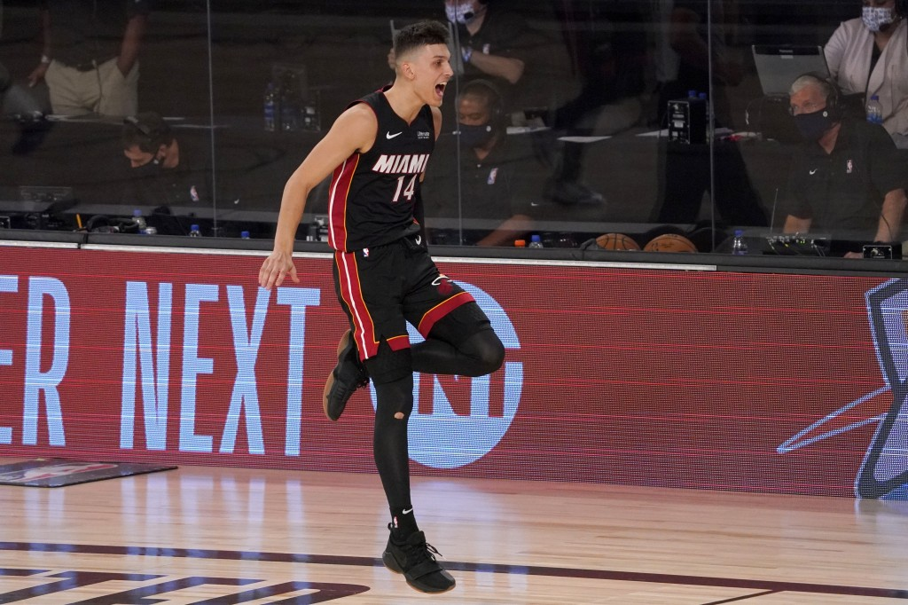 Miami Heat's Tyler Herro (14) celebrates late in the second half of an NBA basketball conference semifinal playoff game against the Milwaukee Bucks on...