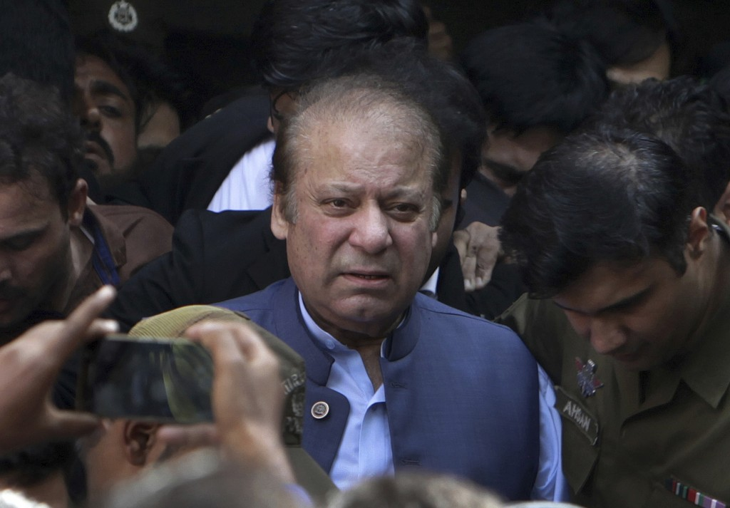 FILE - In this Oct. 8, 2018, file photo, former Pakistani Prime Minister Nawaz Sharif leaves after appearing in a court in Lahore, Pakistan. A Pakista...