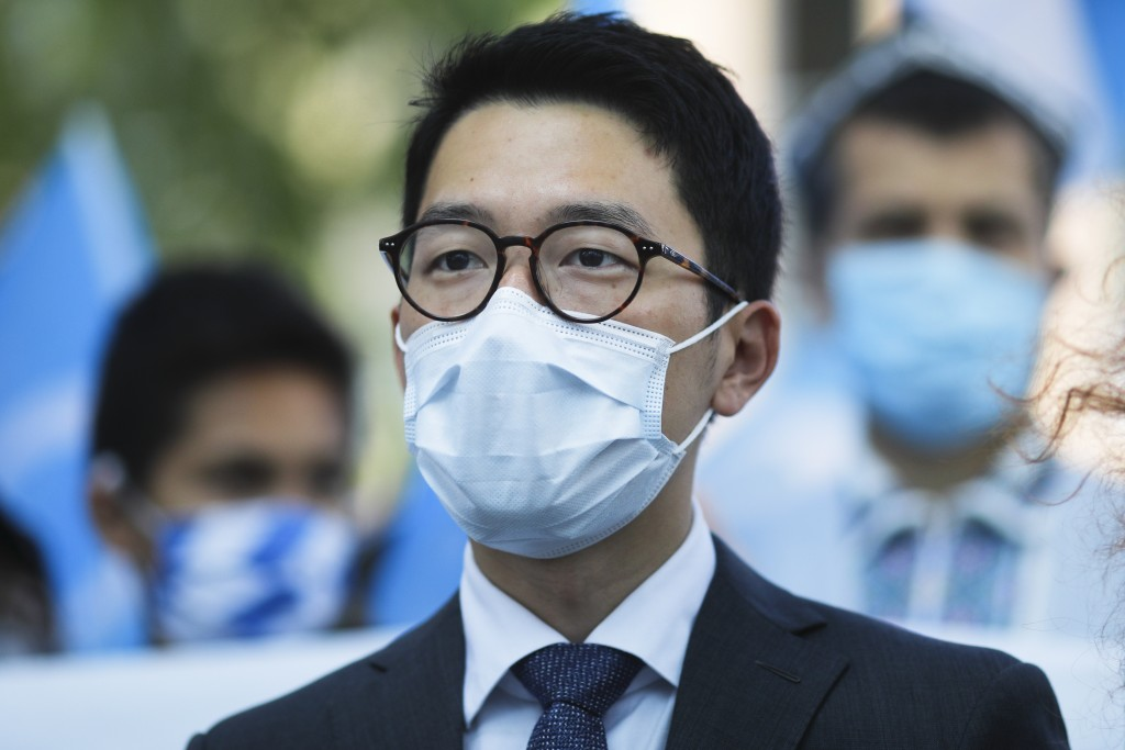 Hong Kong activist Nathan Law takes part in a protest during the visit of Chinese Foreign Minister Wang Yi in Berlin, Germany, Tuesday, Sept. 1, 2020....
