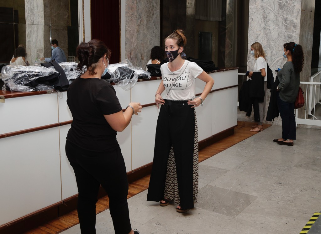 Festival workers receive their uniforms for the 77th edition of the Venice Film Festival at the Venice Lido, Italy, Monday, Aug. 31, 2020. The festiva...