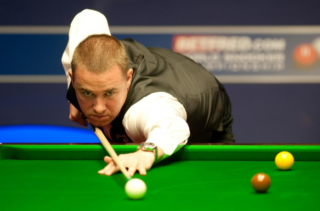 FILE - In this April 24, 2011 file photo, Stephen Hendry at the table in Sheffield, England. Age is proving no barrier to success in snooker so the ta...