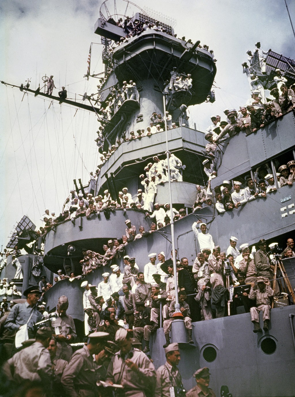 FILE - In this Sept. 2, 1945, file photo, servicemen, reporters, and photographers perch on the USS Missouri for the onboard ceremony in which Japan s...