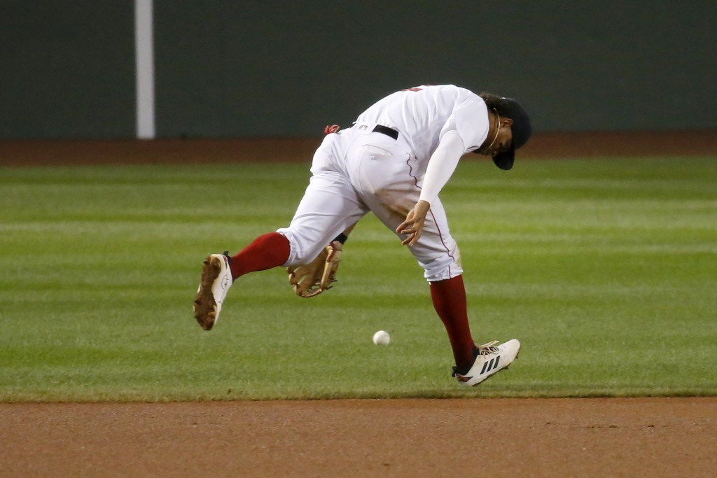 Boston Red Sox shortstop Xander Bogaerts (2) can't get to a ground ball single by Atlanta Braves second baseman Johan Camargo (17) during the eighth i...