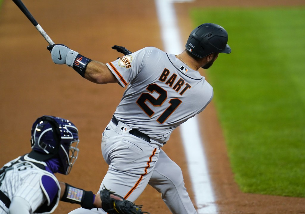 San Francisco Giants' Joey Bart connects for an RBI single off Colorado Rockies starting pitcher Jon Gray in the third inning of a baseball game Tuesd...